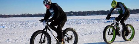 cyclist riding on snow