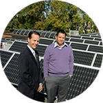 Guys in front of solar panels