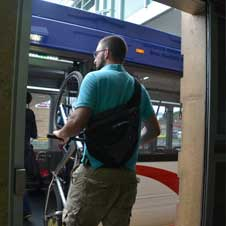 Photo of a bicyclist disembarking onto a Red Line platform