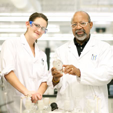 photo of two workers in white lab coats