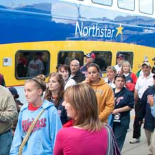 Twins fans get off a Northstar train.