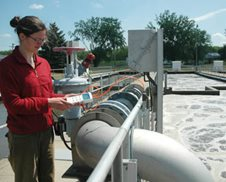 MCES staffer monitoring aeration tank.