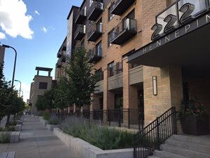 Downtown Minneapolis. Development that supports transit service varies from moderate to high densities.This market-rate project is 112 dwelling units per acre.
