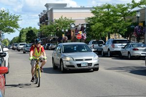Downtown Robbinsdale, West Broadway Avenue. Bicyclists and cars can easily share wider travel lanes.