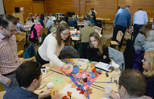 Local planners engage in a creative exercise at a Council-sponsored workshop on community engagement.
