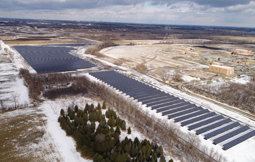 A large array of solar collectors spreads out over a snowbound field at the Metropolitan Council-owned Empire Wastewater Treatment Plant in central Dakota County.