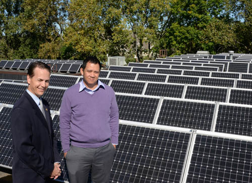 Falcon Heights Mayor Peter Lindstrom (left) and City Administrator Sack Thongvanh check out the city's solar array on the roof of City Hall. The officials are in the vanguard of a movement to bring more solar power to the public sector.