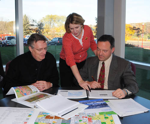 Council staff Sector Representatives provide professional planning and technical assistance to communities.  Pictured here is sector rep Patrick Boylan (right) with Apple Valley planners Tom Lovelace and Margaret Dykes.