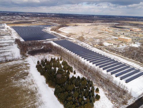 Aerial view of solar arrays in winter.