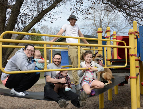 Peter Rosen (second left) and his family enjoy a sunny spring day at Connemara Park in Rosemount. The park is just around the corner from his home and draws visitors from several neighborhoods near the west side city line.