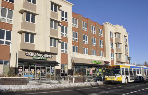 TOD integrates housing, transit, retail and services, and pedestrian access.
