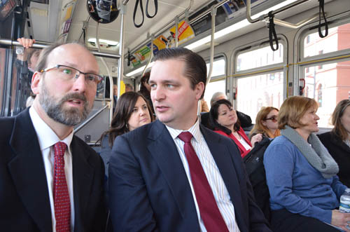 Council Chair Adam Duininck (center) chats with Will Schroeer, executive director of East Metro Strong, during the Gateway Corridor tour.