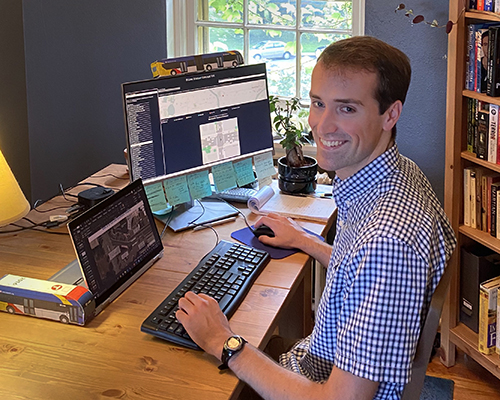 An intern at a computer in a home office.