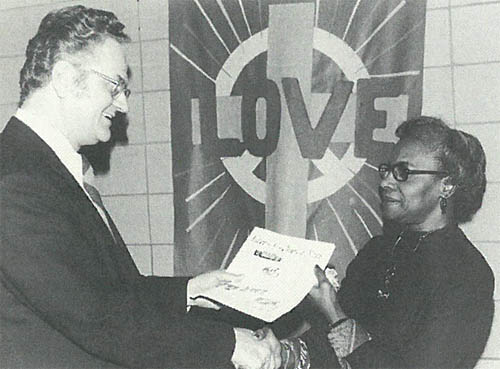 Dr. George E. Whetstone, left congratulates Janabelle Taylor as the incoming president of the Saint Paul Area Council of Churches at the Fall Assembly in November 1972. Taylor was the first woman and the first African American to serve as the Council's president. Her term of office was from 1973 to 1975. (Photo and caption courtesy SPACC – now Interfaith Action of Greater Saint Paul – from a book published for the 100th anniversary of SPACC in 2006.)