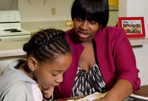 Shaneka Greer Helps her daughter, Naziyah with homework.