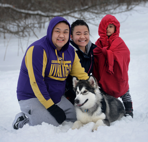 Dog parks have become social affairs for many families across the Twin Cities who bond with other dog owners while their pets frolic, including this family at Battle Creek Regional Park in Saint Paul.