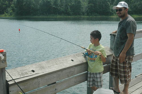 Father and son fishing at Lebanon Hills Regional Park in Dakota County.