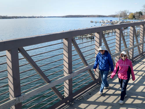 Fred and Lois Parduhn of Excelsior enjoyed a view of Lake Minnetonka's Excelsior Bay while walking on the Minnetonka LRT Regional Trail recently. The 15-mile-long trail traverses lakes, woods, meadows, neighborhoods and several towns south of the big lake.