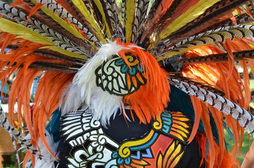 Colors on the costume of a Kalpulli Ketzal Coatlicue dancer are reminiscent of a monarch butterfly.