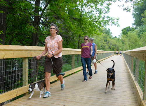 Walkers enjoy the new boardwalk at Phalen-Keller Regional Park in Saint Paul.