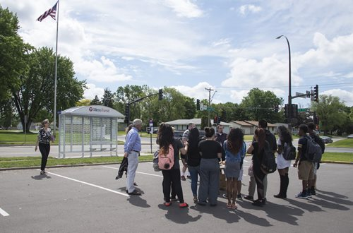 A group of Brooklyn Center high school students adopted a new bus shelter near their school.