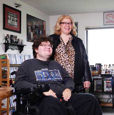 Chris Buhl with his aunt, Marilyn Parker, in his Brooklyn Park apartment.