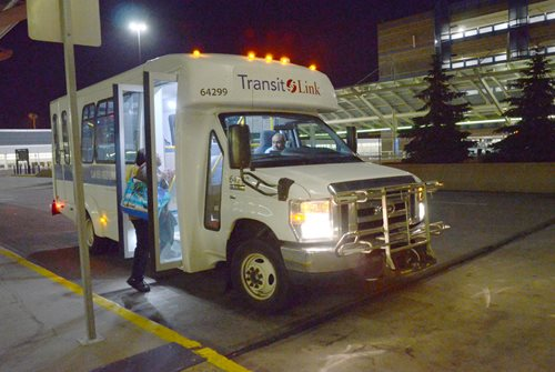 Small buses bring late and early shift workers to the airport from Saint Paul and suburbs.