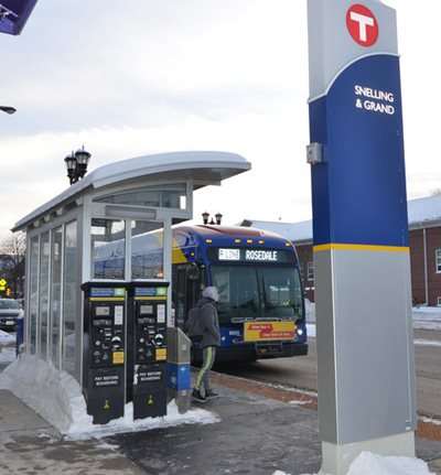 A bus rider walking up to an approaching A Line bus at the Snelling and Grand stop.