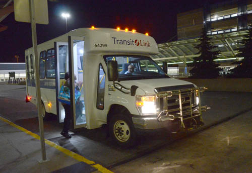 Small Transit Link bus makes late-night pickup of worker at MSP's Terminal One.