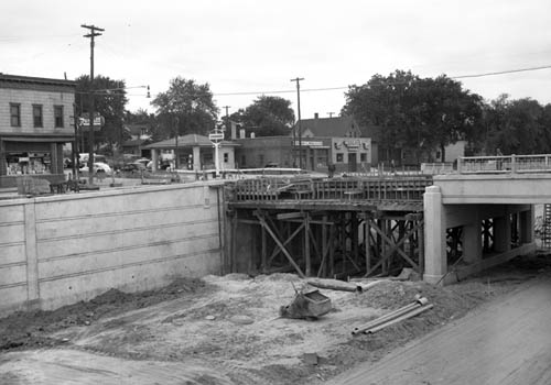 Intersection of Old Hudson Road and Earl Street on Saint Paul's East Side, circa 1949, where a new bridge was being built over the future Highway 12 (and eventually, I-94). It was a streetcar stop and will be a stop on the future METRO Gold Line. (Photo courtesy Minnesota Historical Society)