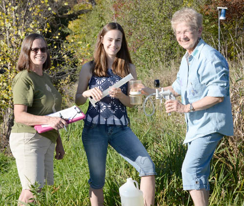 Pat Barrett (left), Haley Jostes (center) and Bonnie Juran share the work of monitoring water quality on Klawitter Pond.