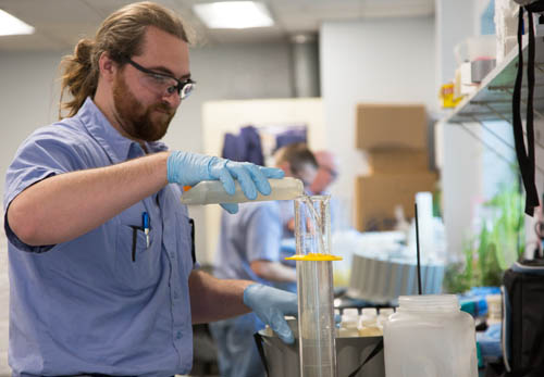 Council employee Nick Alverson tests an industrial wastewater sample from one of the Council's industrial customers.