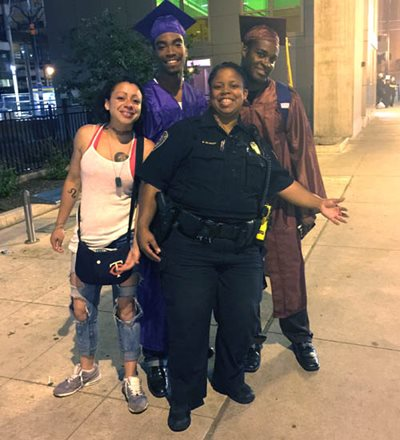 Officer Brooke Blakey on the street with youth she's worked with in the diversion program.
