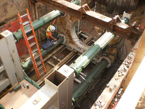 Part of the project entailed digging a tunneling pit to insert a large interceptor pipe underneath railroad tracks.