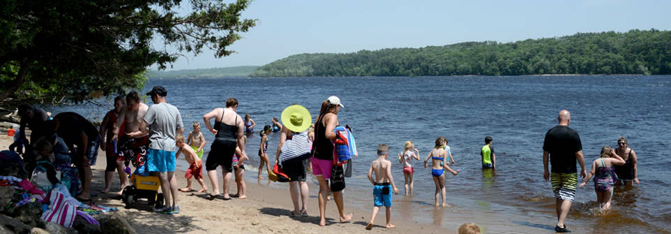 Families and children on St. Croix Bluffs beach.